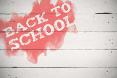 Composite image of back to school text on green and blue splash Royalty Free Stock Images