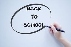 Back to school text handwriting on whiteboard