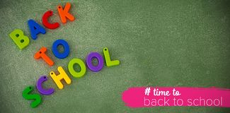 Composite image of back to school text with hashtag. Back to school text with hashtag  against high angle view of back to school text blocks on table Royalty Free Stock Photography