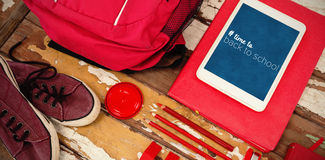 Composite image of back to school text with hashtag. Back to school text with hashtag against high angle view of bag with tablet and shoes on table Stock Photo