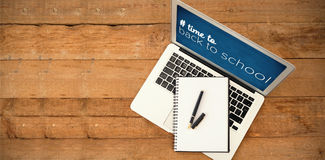 Composite image of back to school text with hashtag. Back to school text with hashtag against laptop with diary and pen on wooden table Stock Images