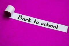 Back to School text, Inspiration, Motivation and business concept on purple torn paper royalty free stock photo