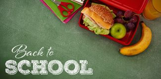 Composite image of back to school text over white background. Back to school text over white background against overhead view of burger in lunch box Royalty Free Stock Image