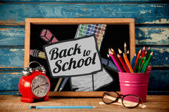 Composite image of back to school text on paper with pen Royalty Free Stock Image