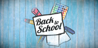 Composite image of back to school text on paper with pen. Back to school text on paper with pen against wooden planks Royalty Free Stock Photos