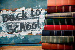 Composite image of back to school text on pink splash Royalty Free Stock Photography