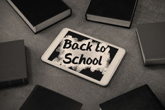 Composite image of back to school text on pink splash Royalty Free Stock Photo