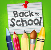 Back to School Text on Pinned Piece of Paper with School Supplies Royalty Free Stock Photos
