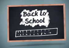 Back to school text with ruler on blackboard Stock Photos