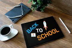Back to school text on screen. Education and e-learning concept. royalty free stock photography