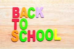 Back to School text with shadow. On wooden background Stock Photo