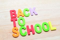 Back to School text with shadow. On wooden background Royalty Free Stock Photos