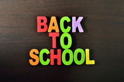 Back to School text with shadow on wooden background Royalty Free Stock Image