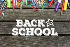Back to School text on wooden background with school supplies Stock Photos