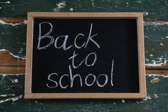 Back to school text written on chalkboard. Close-up of back to school text written on chalkboard Stock Photos