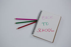 Back to school text written on spiral book. Close-up of back to school text written on spiral book Royalty Free Stock Image