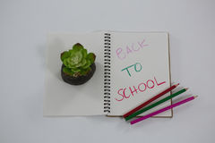Back to school text written on spiral book. Close-up of back to school text written on spiral book Royalty Free Stock Photos