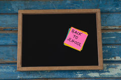 Back to school text written on sticky note. Close-up of back to school text written on sticky note Royalty Free Stock Images