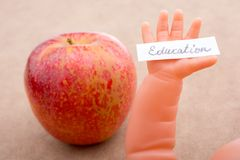 Back to school theme with an apple. Back to school theme with a red apple Royalty Free Stock Photo