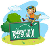 Back to school theme with boy jumping Royalty Free Stock Photography