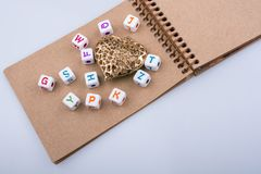 Back to school theme with letter cubes Stock Photos