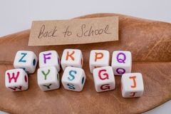 Back to school theme with letter cubes Stock Images