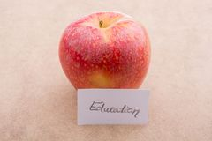 Back to school theme with an apple. Back to school theme with a red apple Stock Photo