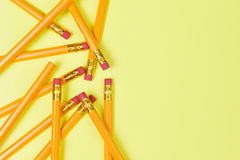 Back to School theme. Top view of a group of pencils on a yellow background with copy space Stock Photography
