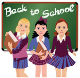 Back to School. Three cute schoolgirls Royalty Free Stock Image
