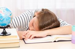 Free Back To School. Tired Little Child Girl Sleeping On The Desk While Doing Homework Royalty Free Stock Images - 188406049
