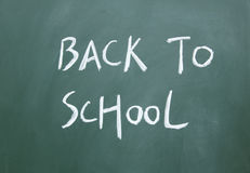 Back to school title. Written with chalk on blackboard Stock Images