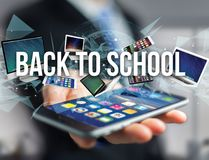 Back to school title surounded by device like smartphone, tablet Stock Image