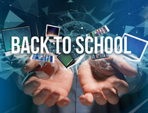 Back to school title surounded by device like smartphone, tablet Royalty Free Stock Photo