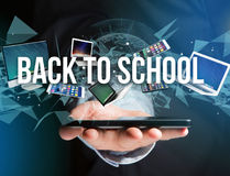 Back to school title surounded by device like smartphone, tablet Royalty Free Stock Photos