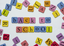 Back to school. Toy magnetic letters spelling the word Back to school Royalty Free Stock Photos