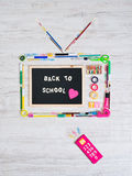 Back to school on tv. Funny colorful vintage television composed by colorful stationery objects, back to school concept Stock Photos