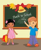 Back to school. Two happy children are standing near the school board stock image
