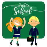 Back to school, two students, schoolchild, cute boy and girl in the form   Royalty Free Stock Photos