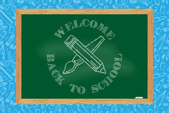 Back To School typographical background on chalkboard. Royalty Free Stock Photos