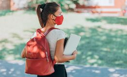 Free Back To School University Student Girl Wearing Covid Mask Walking On Campus With Backpack, Books And Laptop. Corona Royalty Free Stock Photography - 195305907