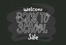Welcome Back to school sale - doodles lettering quote on black chalkboard. hand drawn logo phrase. Grotesque script text for Cards royalty free illustration