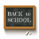 Back to school. Vector illustration of a chalkboard and chalks with text back to school Stock Image