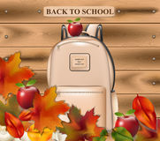 Back to school vector. School bag and autumn leaves on wooden background background Royalty Free Stock Photos