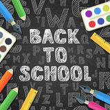 Back to school vector sketch lettering and flat stationery icons. Pen, pencil, brush, paints, ruler on black board background. Royalty Free Stock Photography