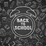 Back to school vector sketch lettering and hand drawn watercolor alarm clock. Black board background. Royalty Free Stock Image