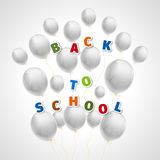 Back to school with white balls. Composition of many white air balloons and an inscription back to school from cartoon sticker letters of different colors on a Stock Images
