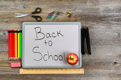 Back to school on white board with school supplies Stock Image