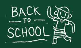 Back to school. White chalk drawing Back to school with cute boy on green board Stock Photos