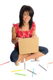Back to school woman. Attractive young woman on a white background with school or office supplies Stock Photo