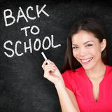 Back to school - woman teacher smiling blackboard Royalty Free Stock Photos